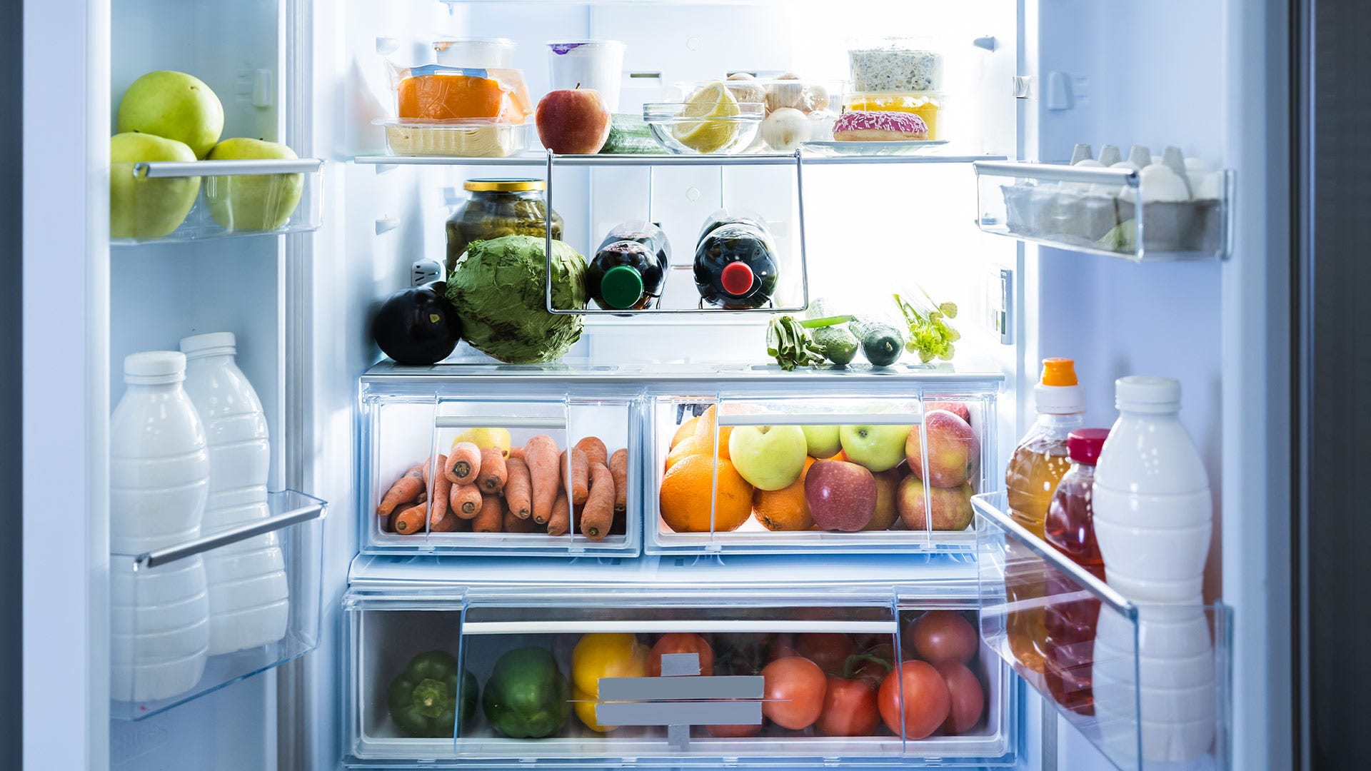 An open refrigerator with food inside.