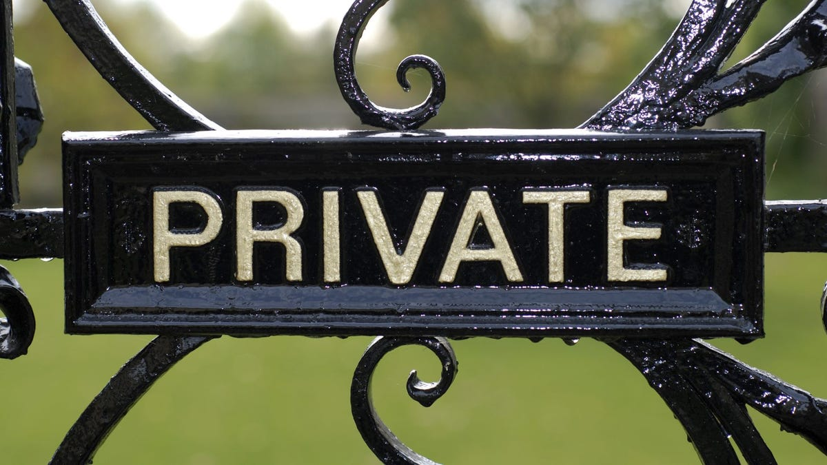 """A """"Private"""" sign on an iron gate."""