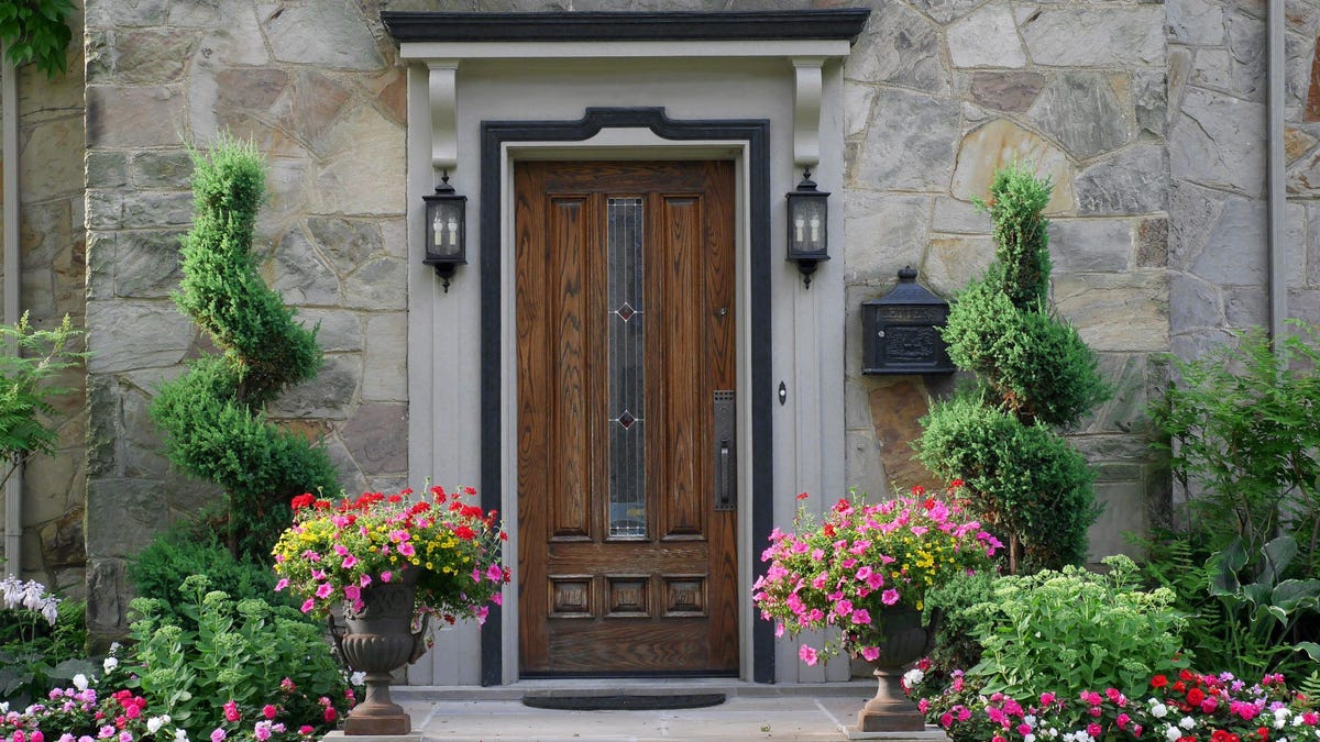 Front door surrounded by flowers.