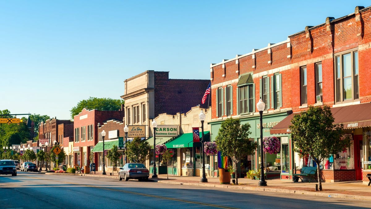 A main street lined with old brick buildings in Bedford, Ohio.