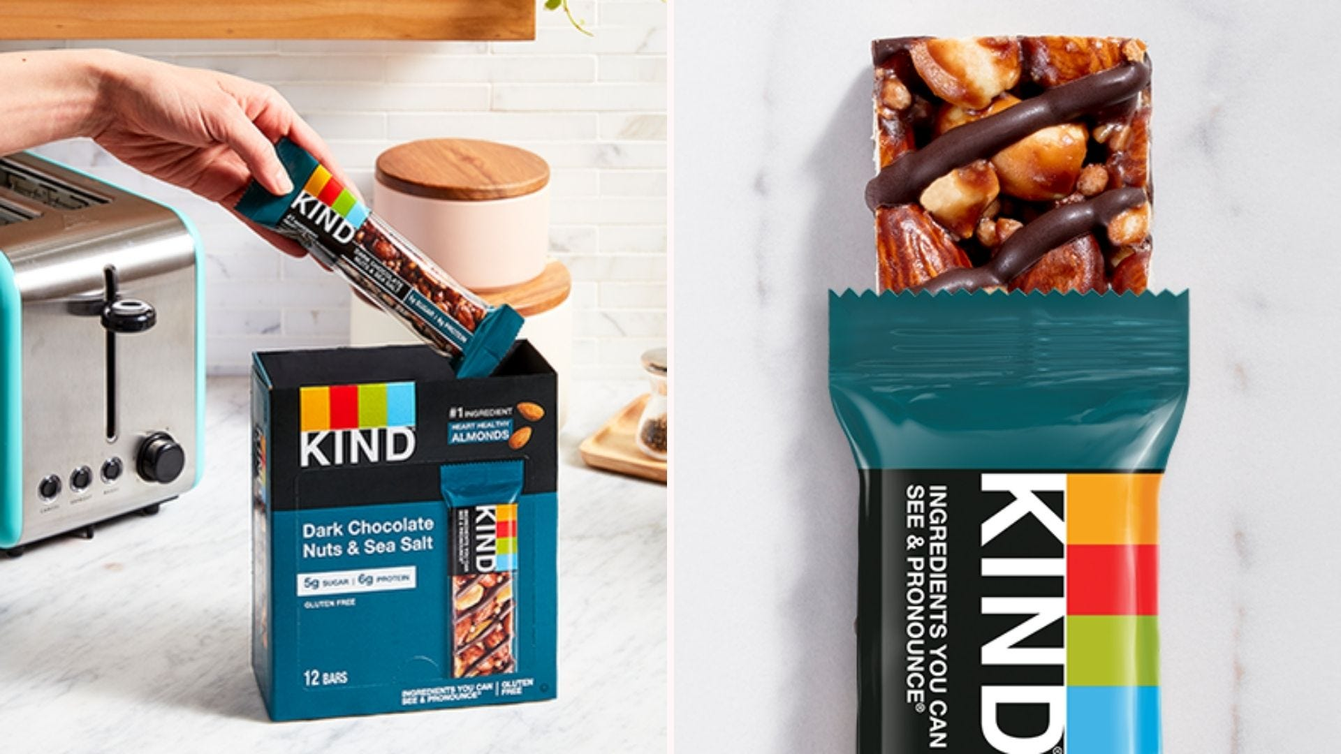 A hand reaching in to grab a Kind Bar from the box.