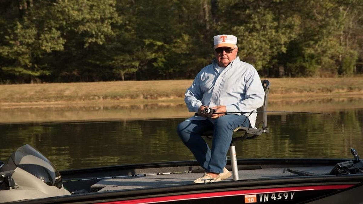 man fishing while sitting in a boat seat on a speedboat