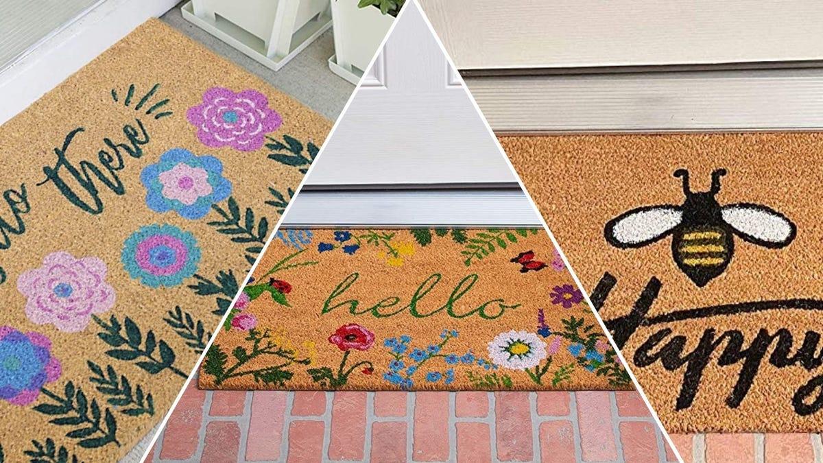 """A floral """"hello there"""" doormat; a floral """"hello"""" doormat; a """"bee happy"""" doormat"""