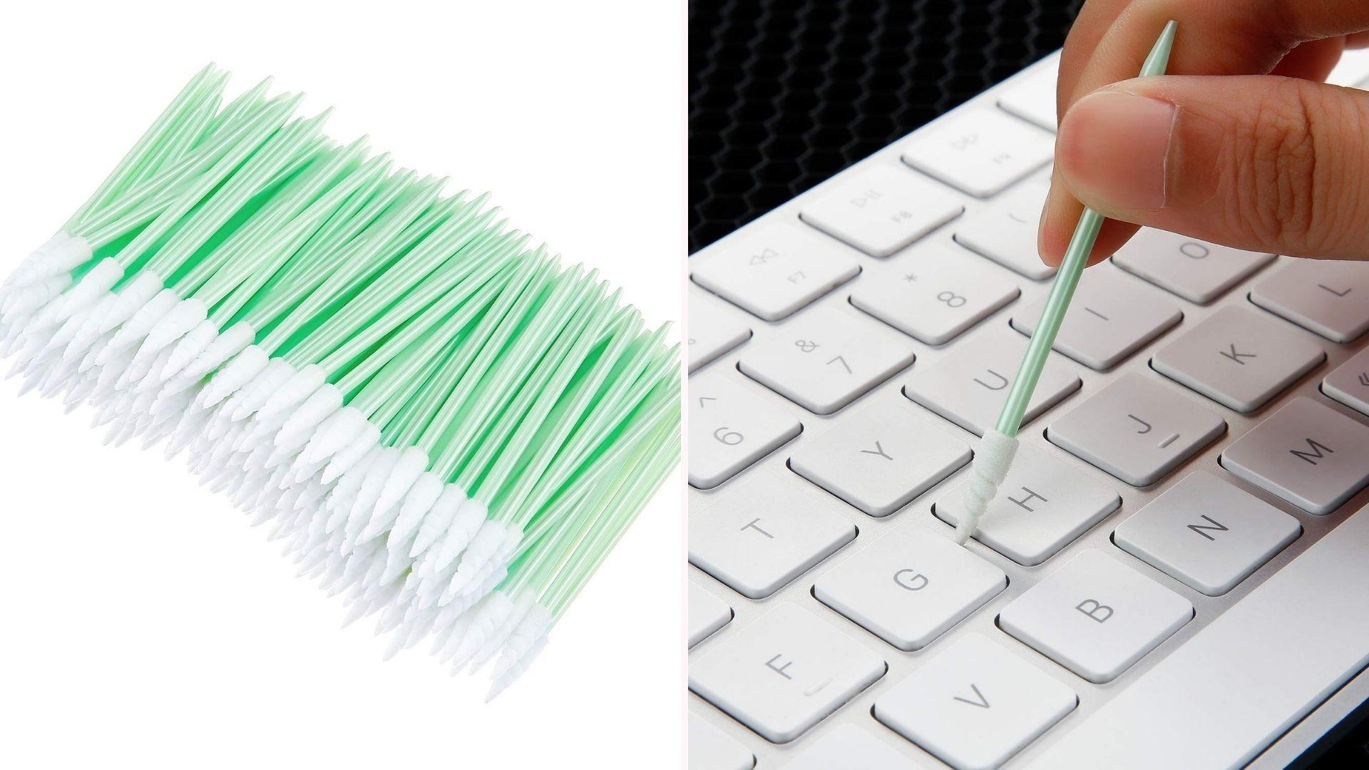Swabs being used to clean computer keyboard.