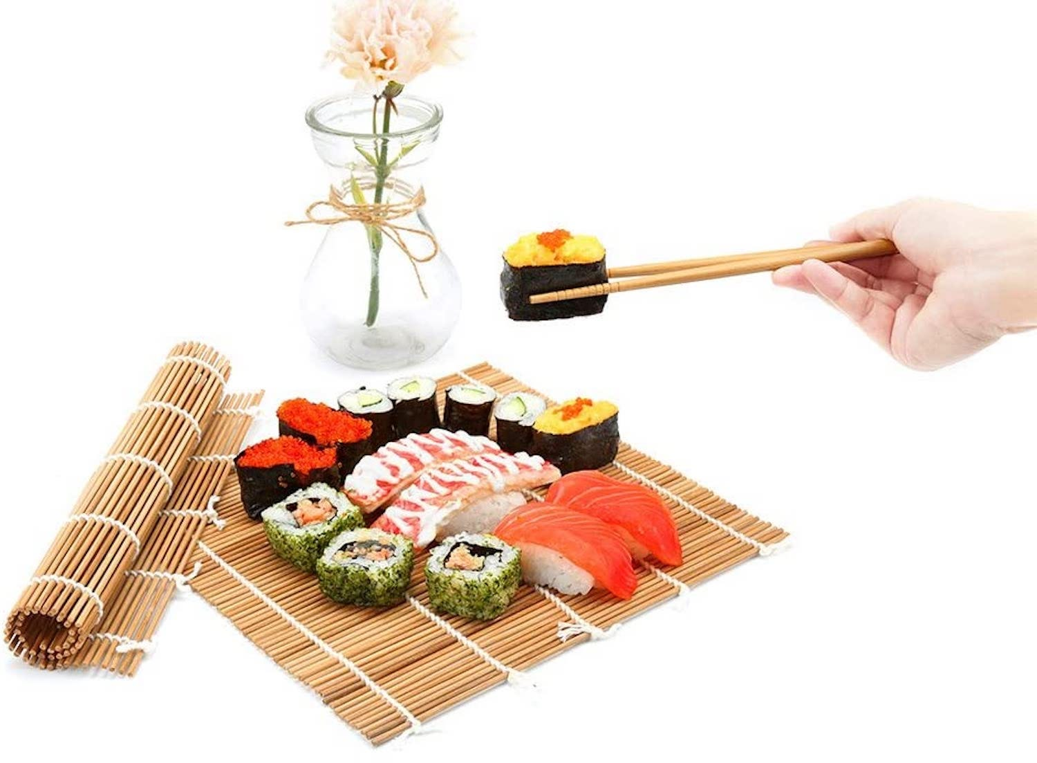 A bamboo mat with assorted sushi sitting on it