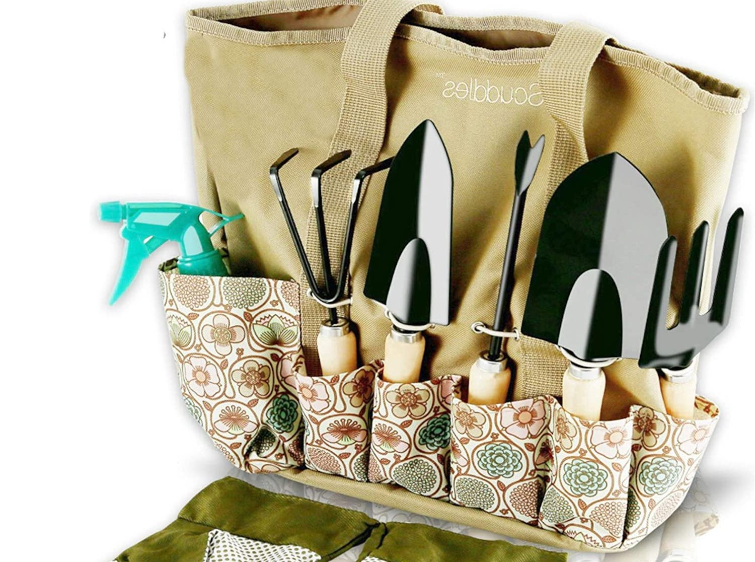 A canvas tote bag with small garden tools in pockets along the outside