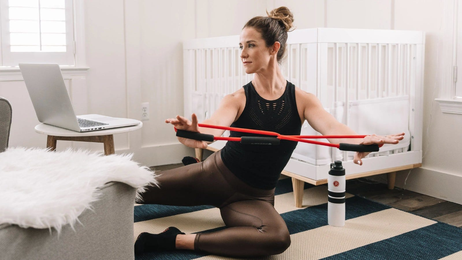 woman doing barre with a resistance band