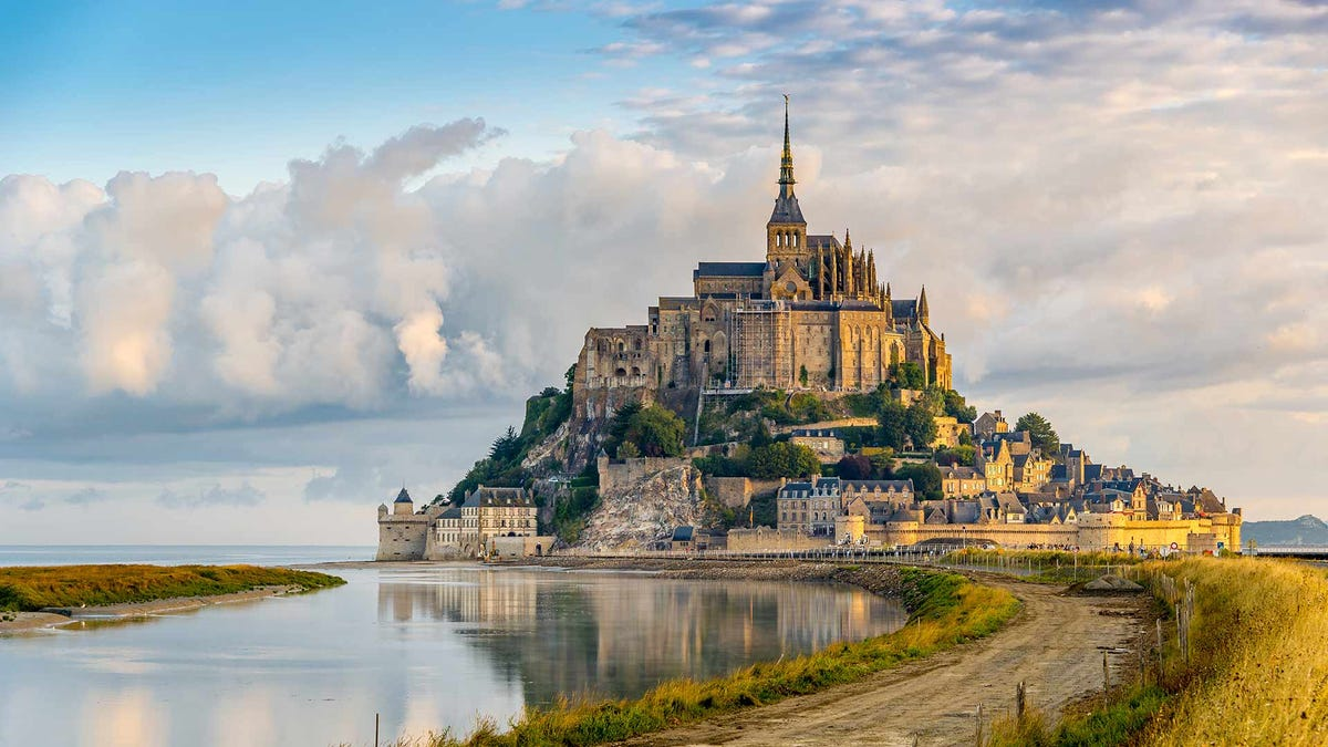 A French monastery built on a peninsula off the coast.