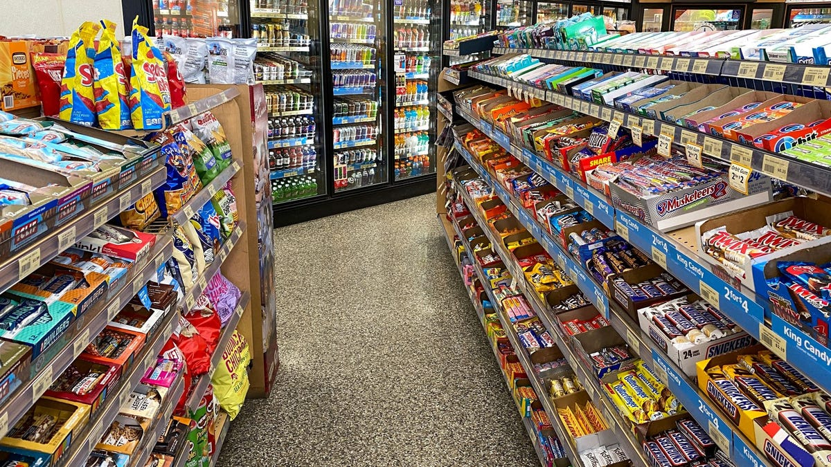 The snack aisle at a gas station convenience store.