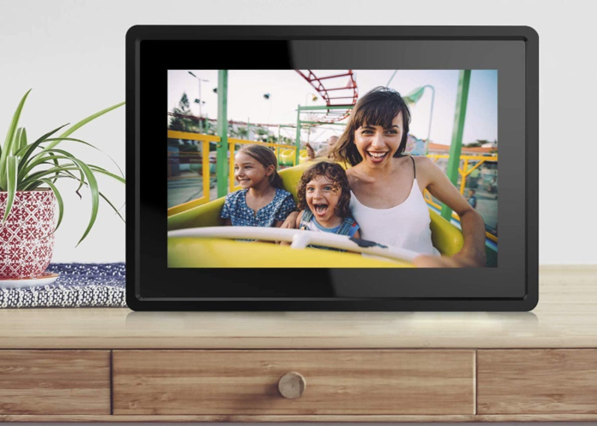 framed photo of mom and children in a roller coaster on a digital screen on a table