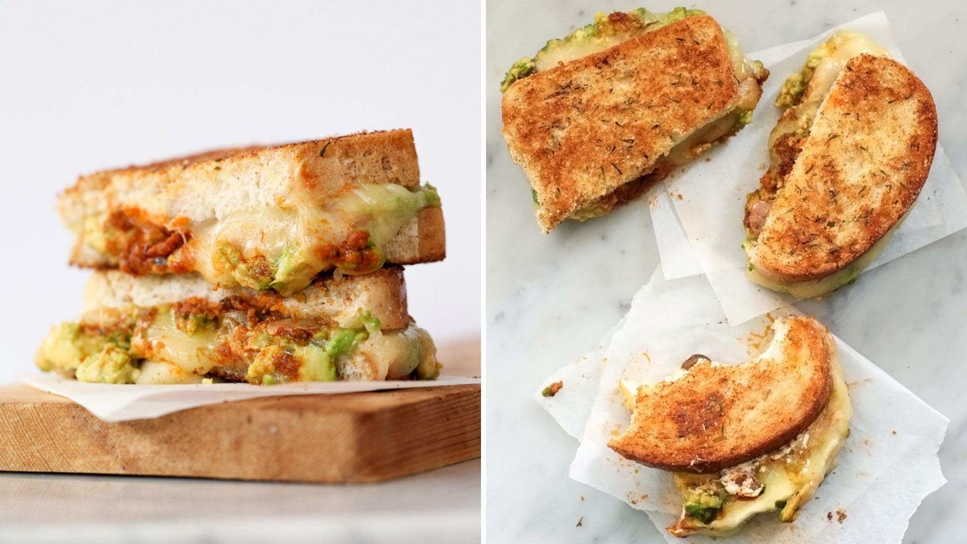 A grilled cheese sandwich with avocado is stacked on a cutting board and three pieces sit on a table.