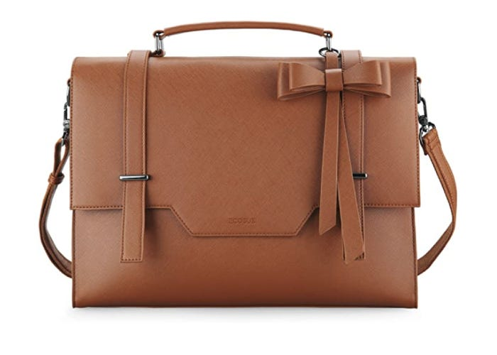 a leather messenger bag with a bow detail