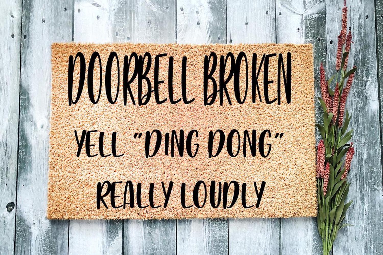 "Doormat reading ""Doorbell Broken - Yell 'Ding Dong' Really Loudly"""
