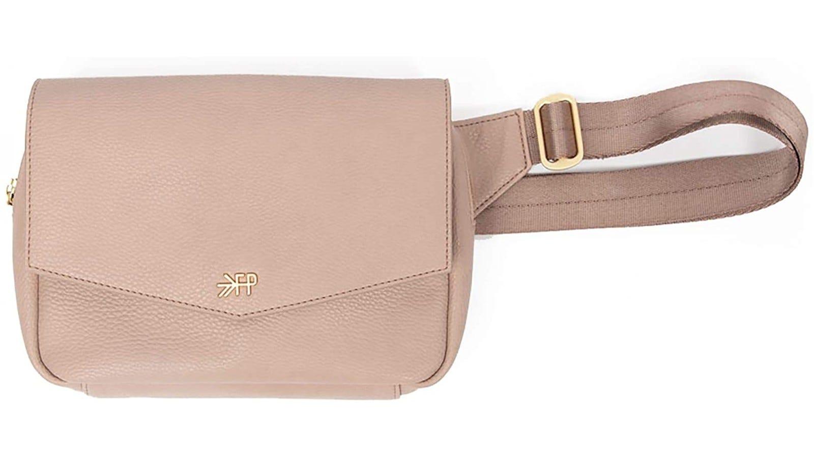 a blush colored belt bag