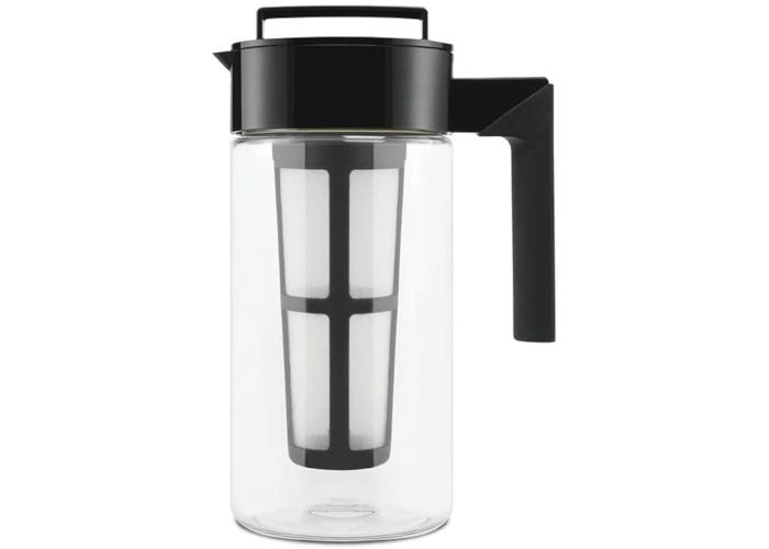 Tall plastic cold brew coffee maker with a clear pitcher, black silicone handle, and fine mesh interior filter