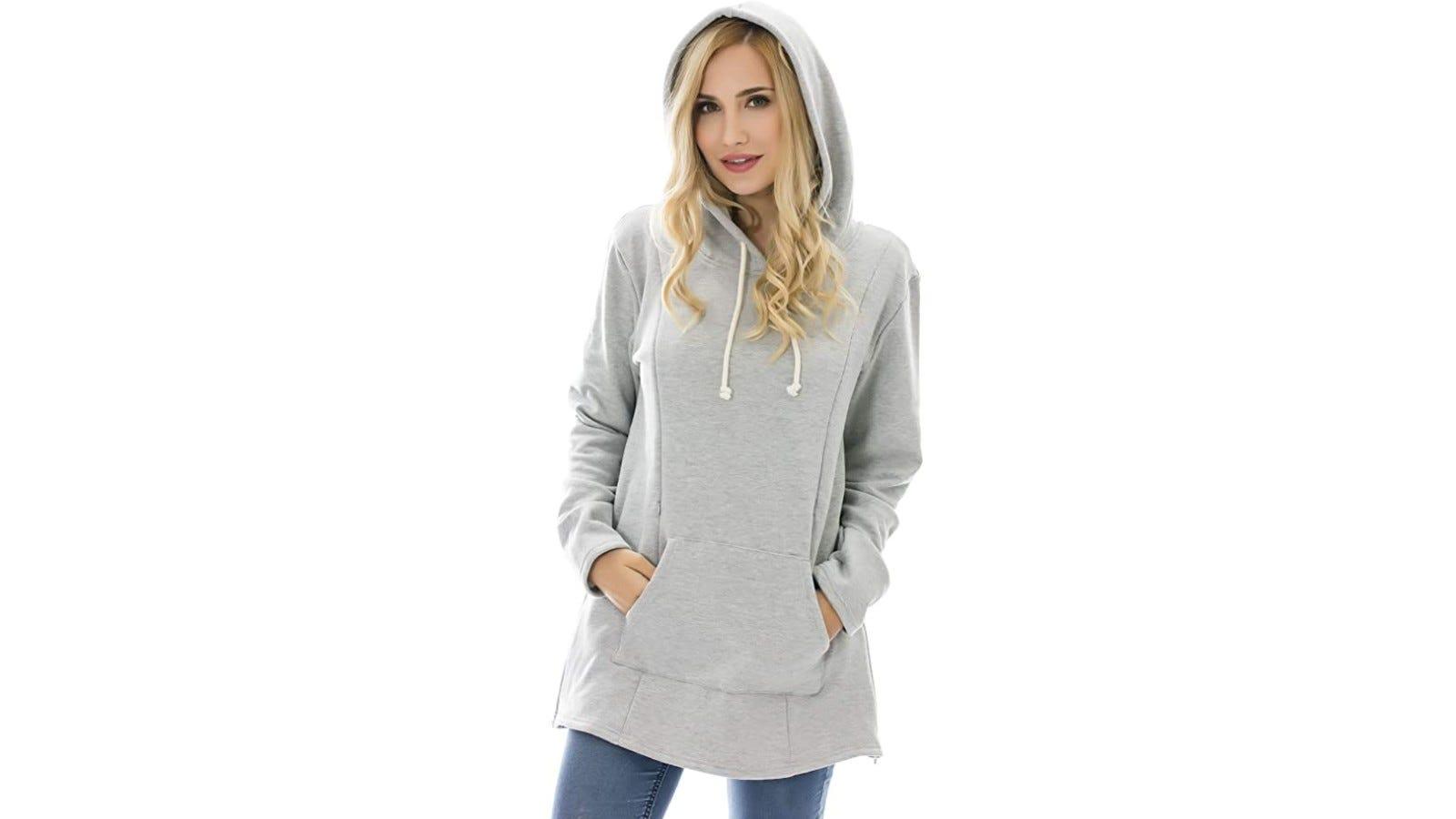 blonde woman wearing a gray sweatshirt