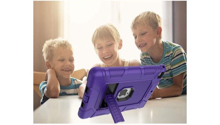 three kids looking at an iPad in a case that's standing up