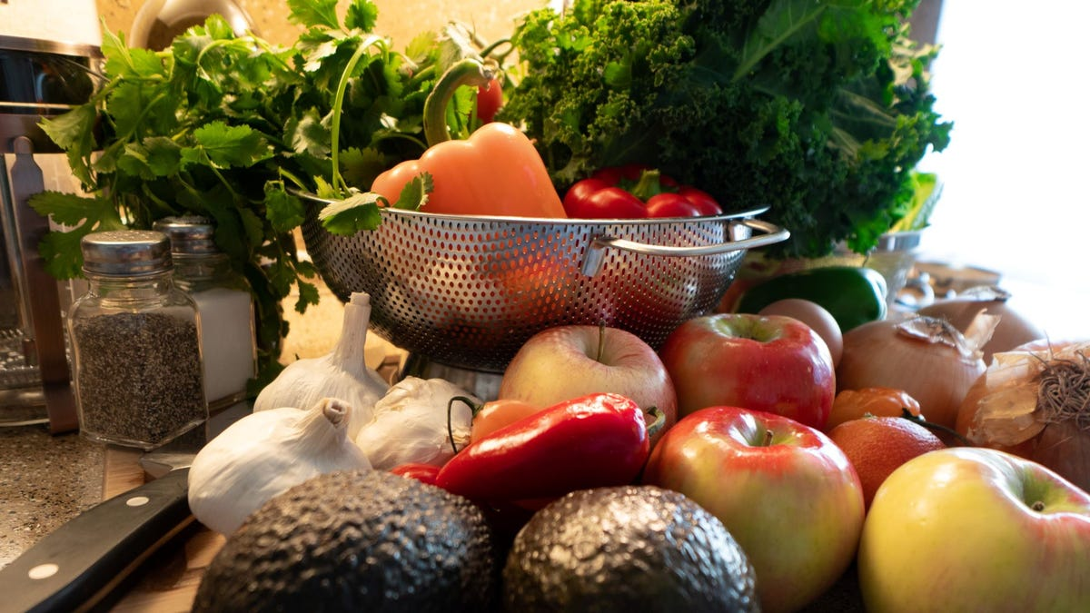 Fresh fruits and vegetables on a counter.