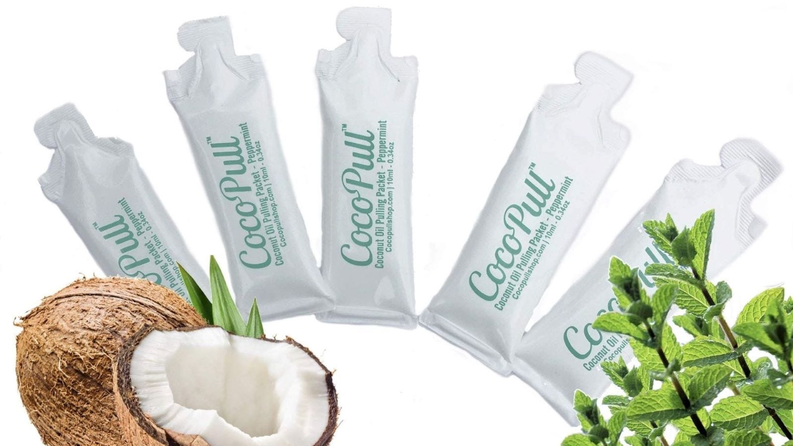 Five tubes of CocoPull Coconut Oil next to a coconut that's been sliced open.