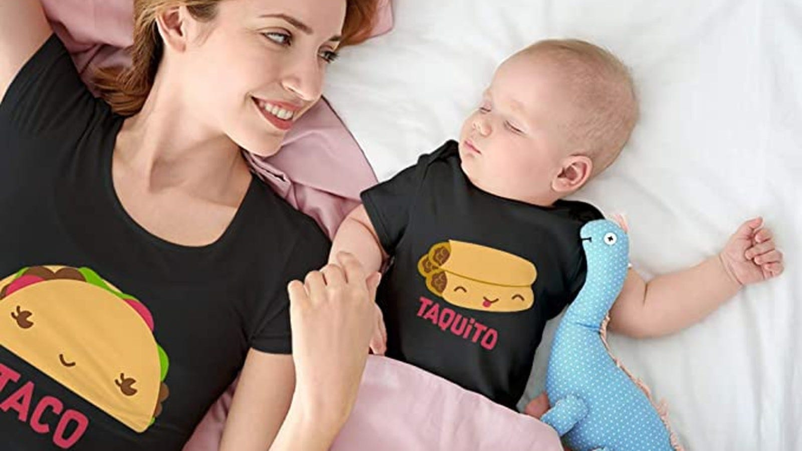 mom laying next to sleeping baby wearing matching black taco and taquito shirt and onesie