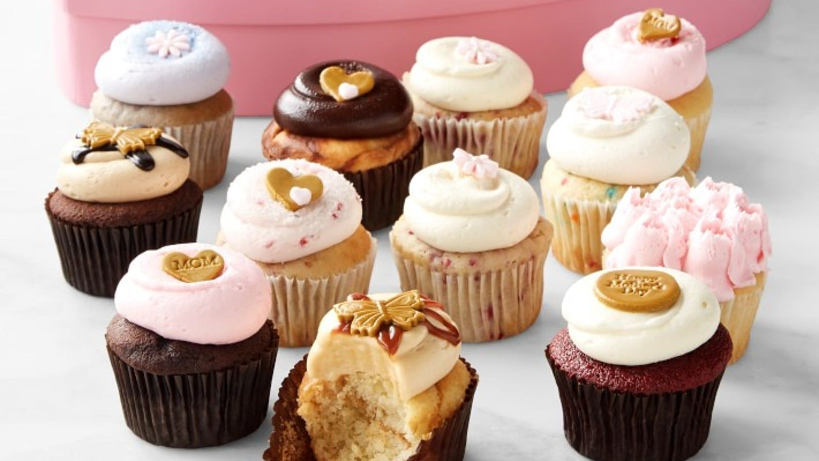an assortment of frosted cupcakes