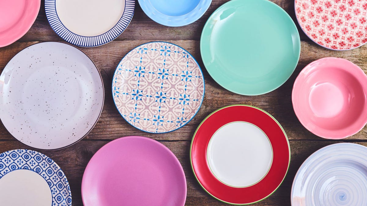 A variety of plates in different colors and designs.