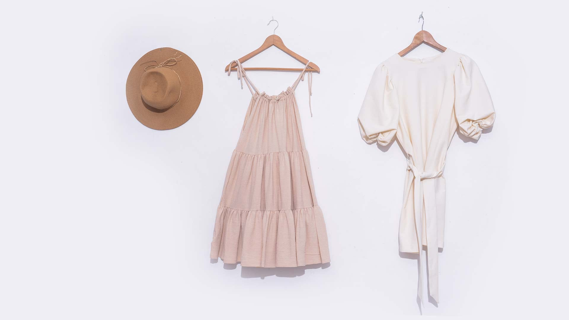 Items of clothing hung against a white background.