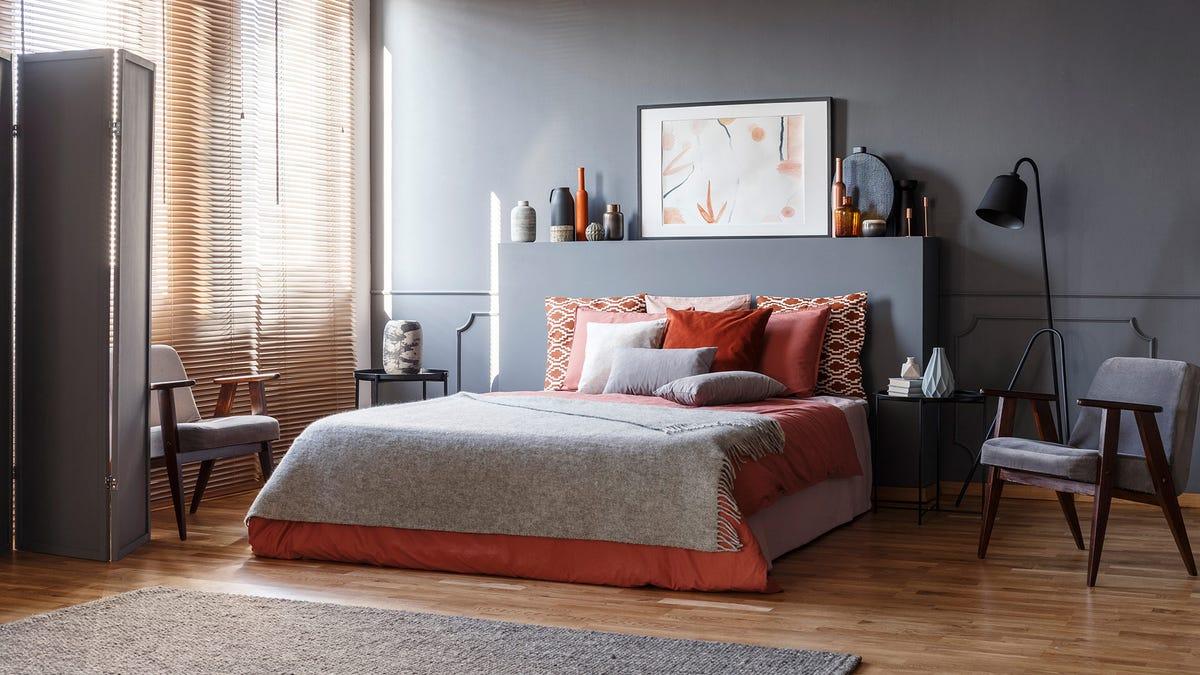 A stylish bedroom with hardwood floors.