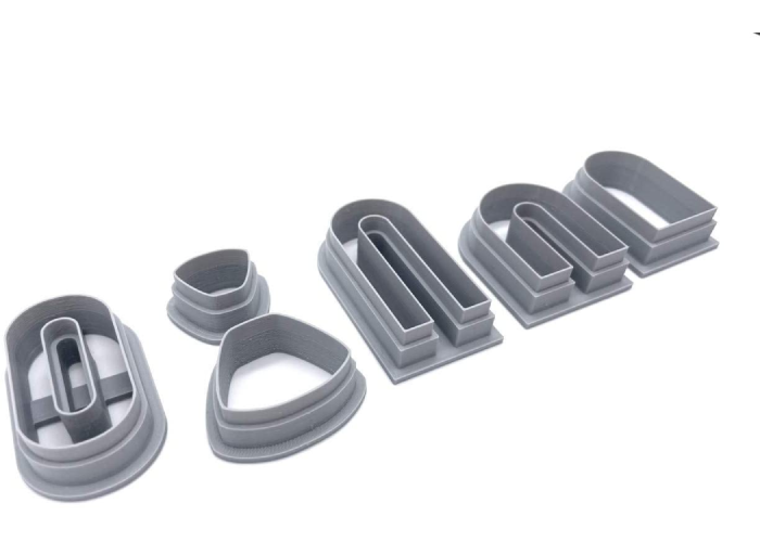 plastic polymer clay cutters in five different shapes.