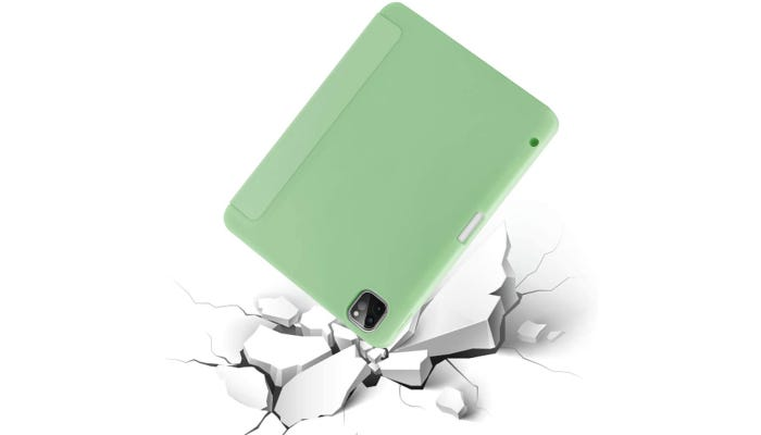 a light green iPad case on an iPad shown hitting broken ground but staying intact