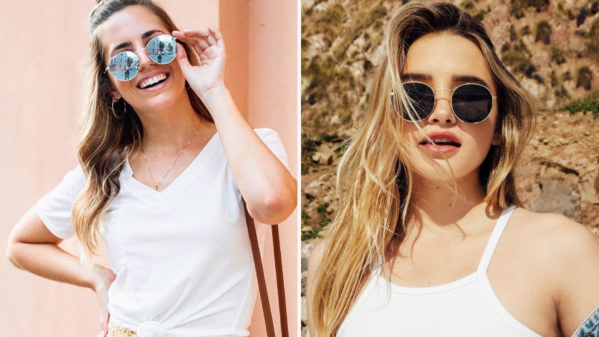 Two women in white shirts wearing round sunglasses