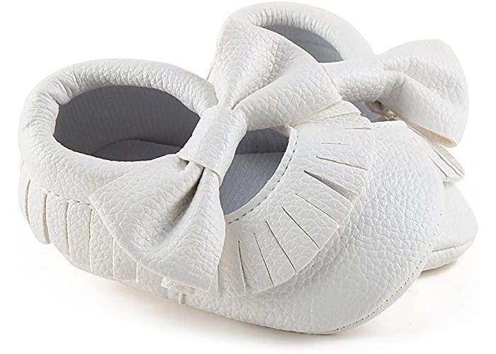 white baby girl textured moccasins with bow across the top of the foot