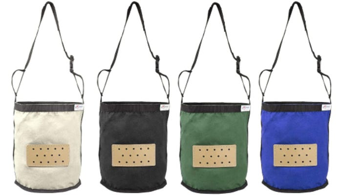 From left to right, four hanging canvas bag feeders in white, black, green, and blue are displayed against a white background. Each feeder has a tan rectangle with breathing holes.