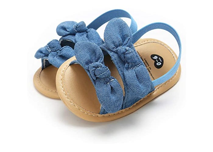 brown-bottomed baby girl sandals with blue straps and bows