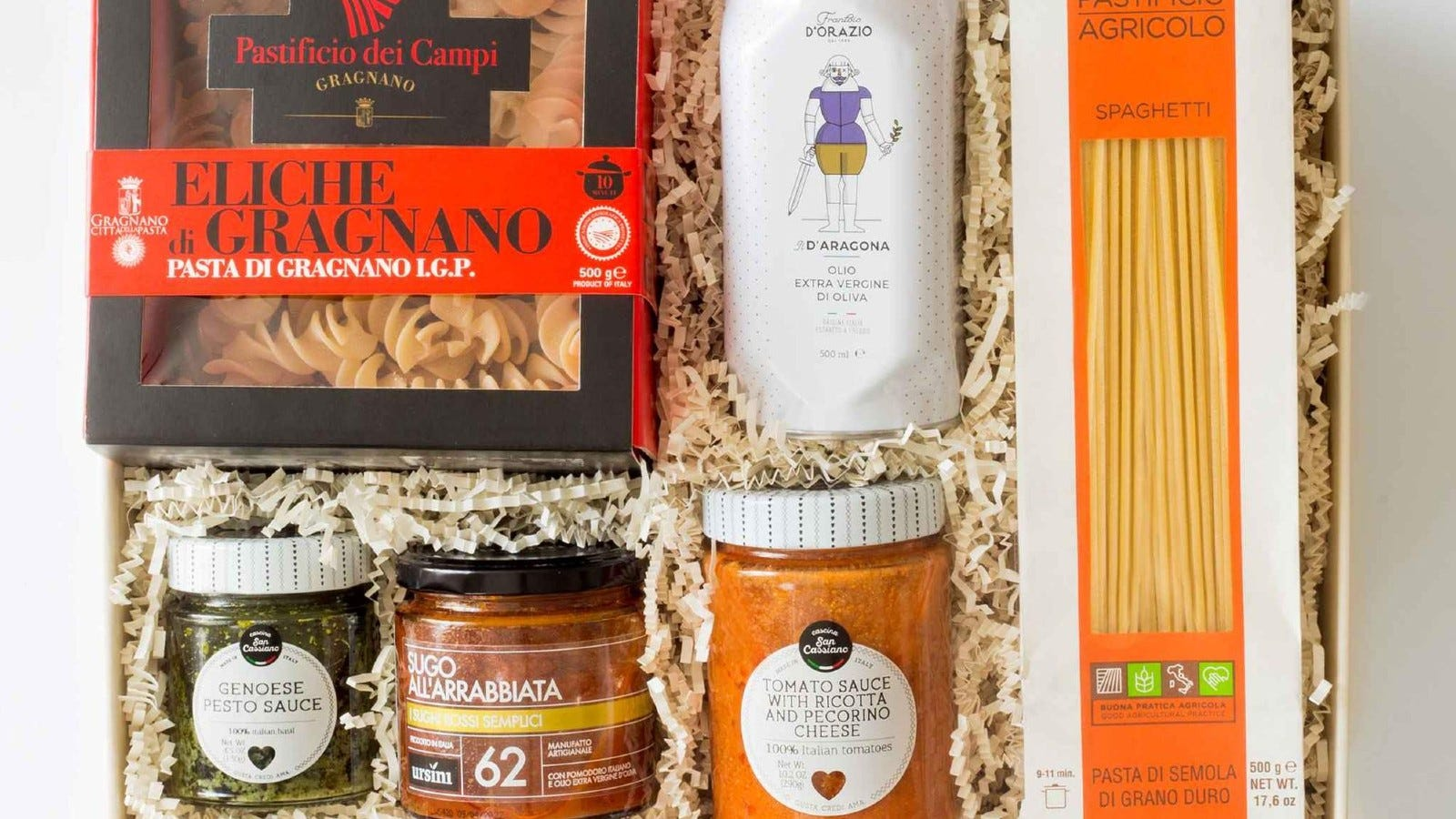 gift box that includes two boxes of pasta, olive oil, and three types of pasta sauces