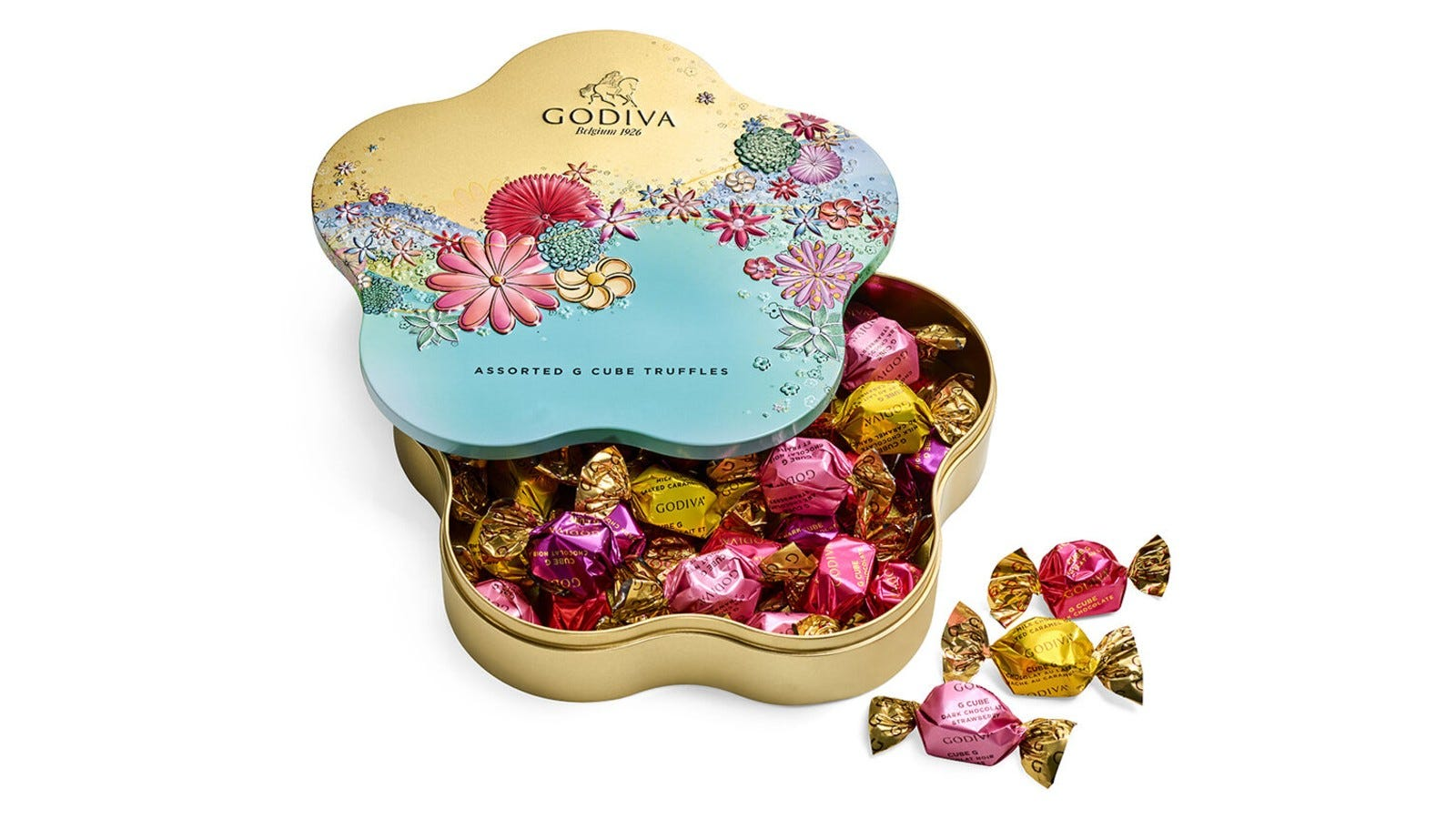 a gold, pink, and blue flower shaped tin filled with individually wrapped truffles