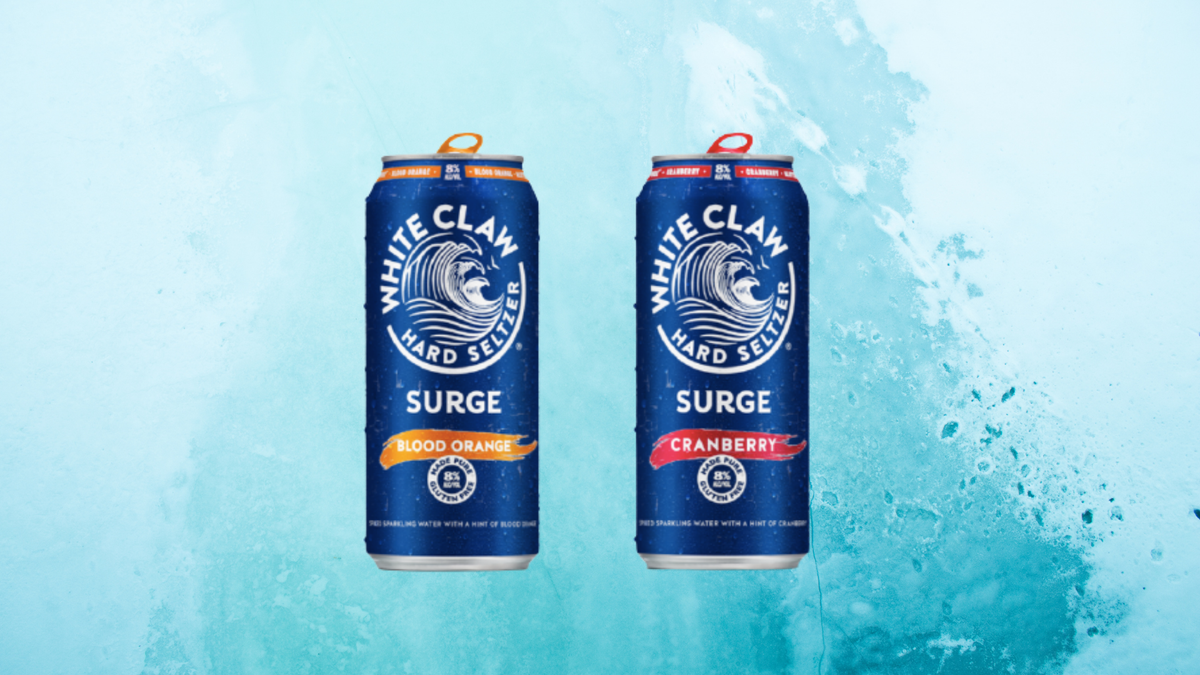 Two cans of White Claw Surge sit against an ocean wave background.