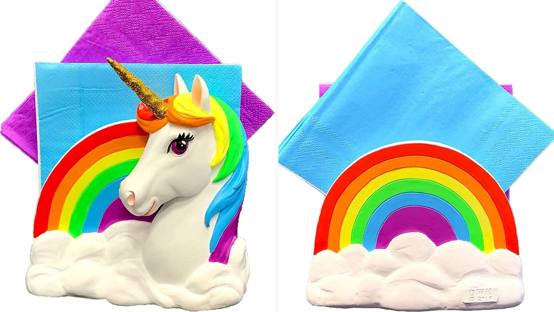 Unicorn and rainbow napkin holder displayed with colorful napkins.