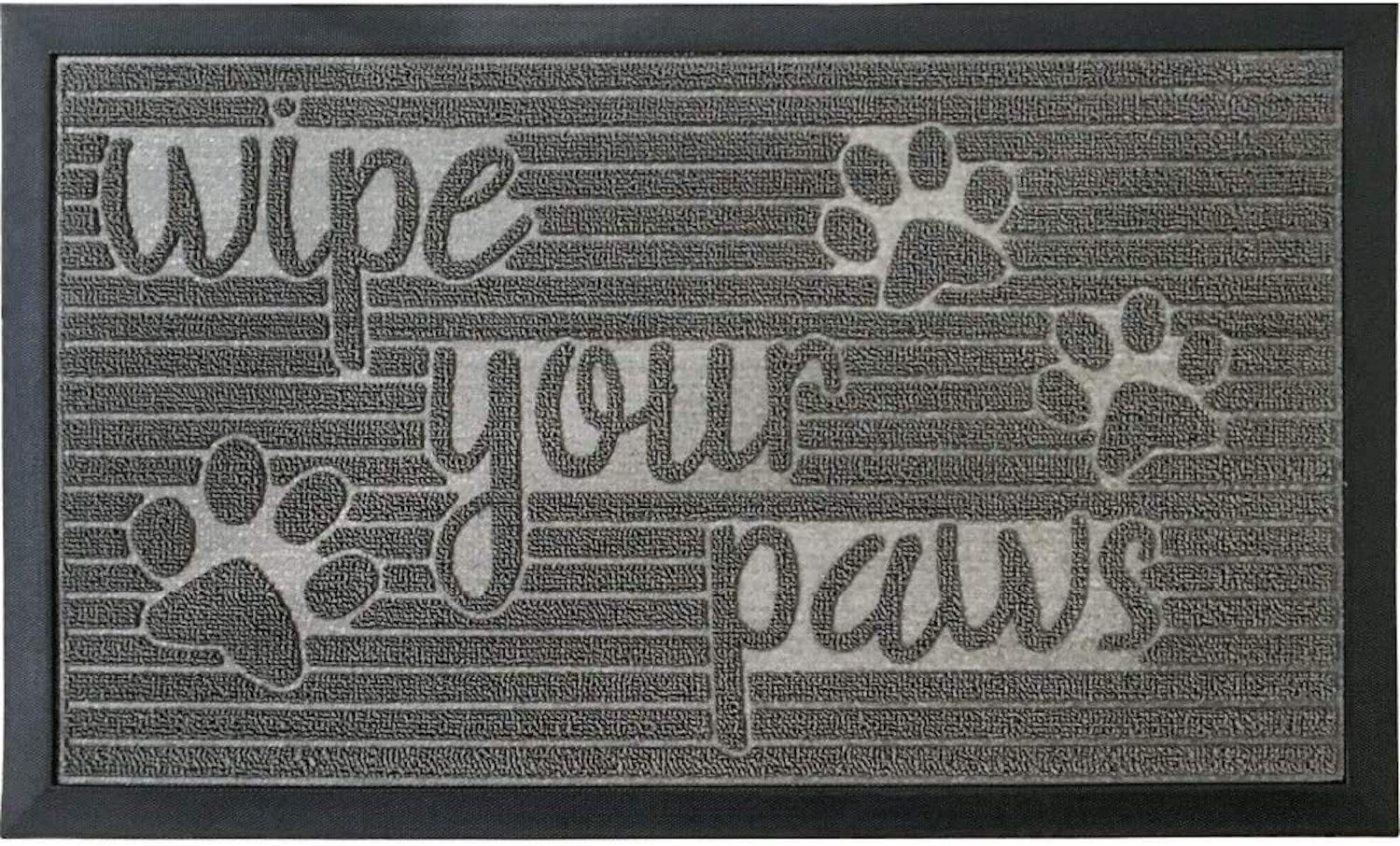 """A gray doormat with pawprint designs reading """"Wipe Your Paws"""""""