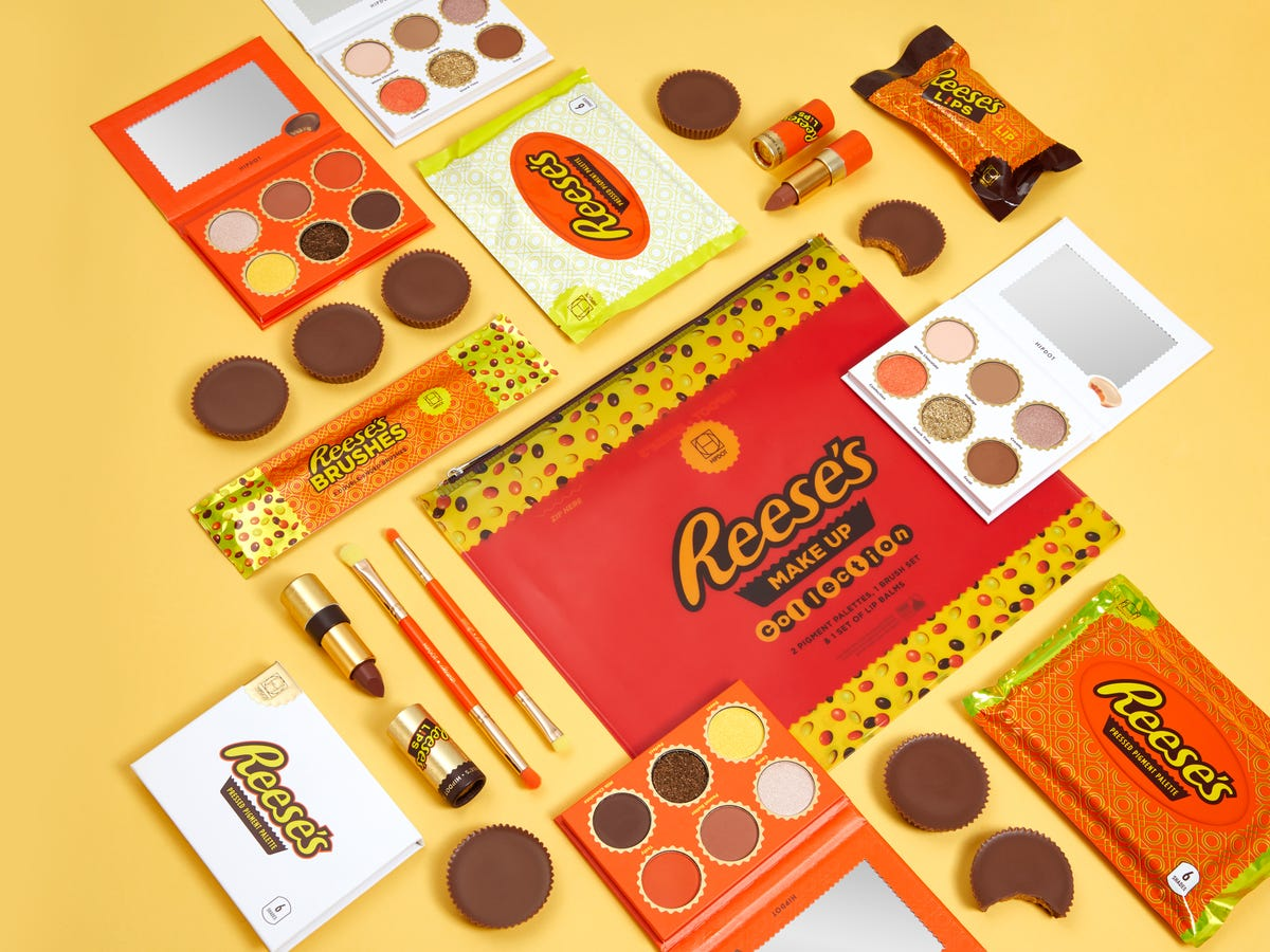 Reese's makeup collection, including palettes, lip balms, and brushes.