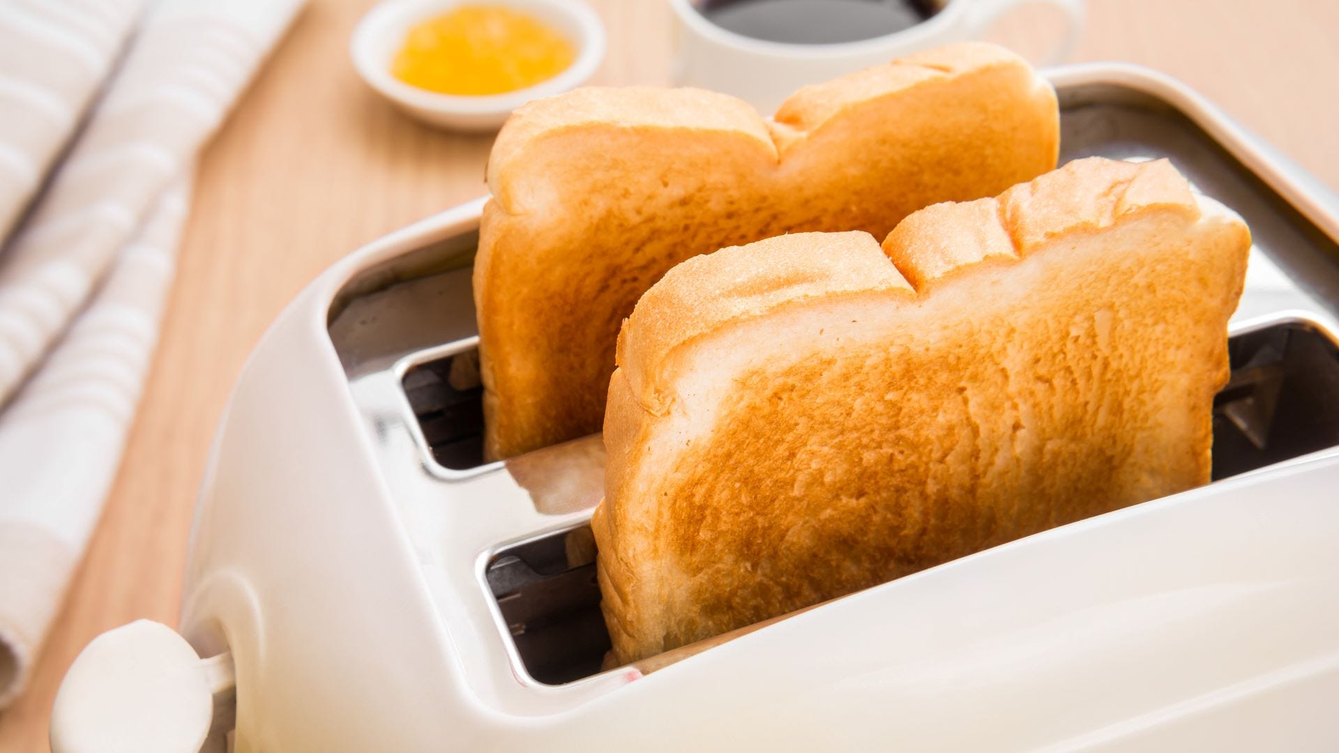 Two slices of toast in a toaster.