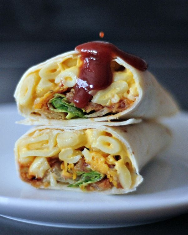 Two BBQ Mac and Cheese Burritos stacked on top of each other.