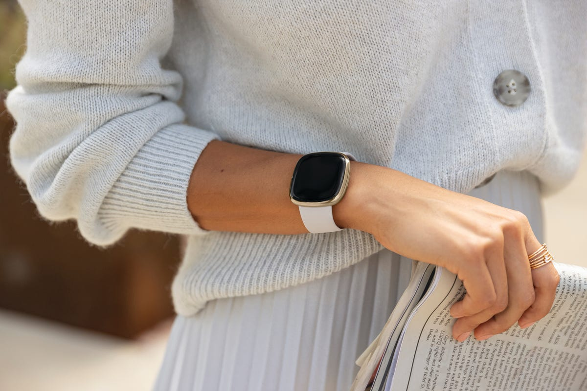 A Fitbit on a woman's wrist.