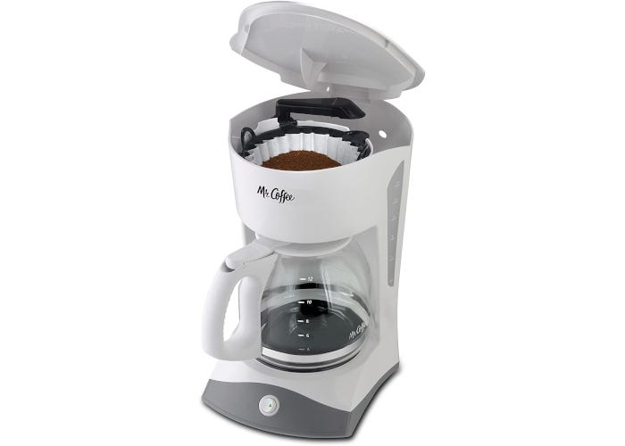 Compact white drip coffee maker with glass carafe