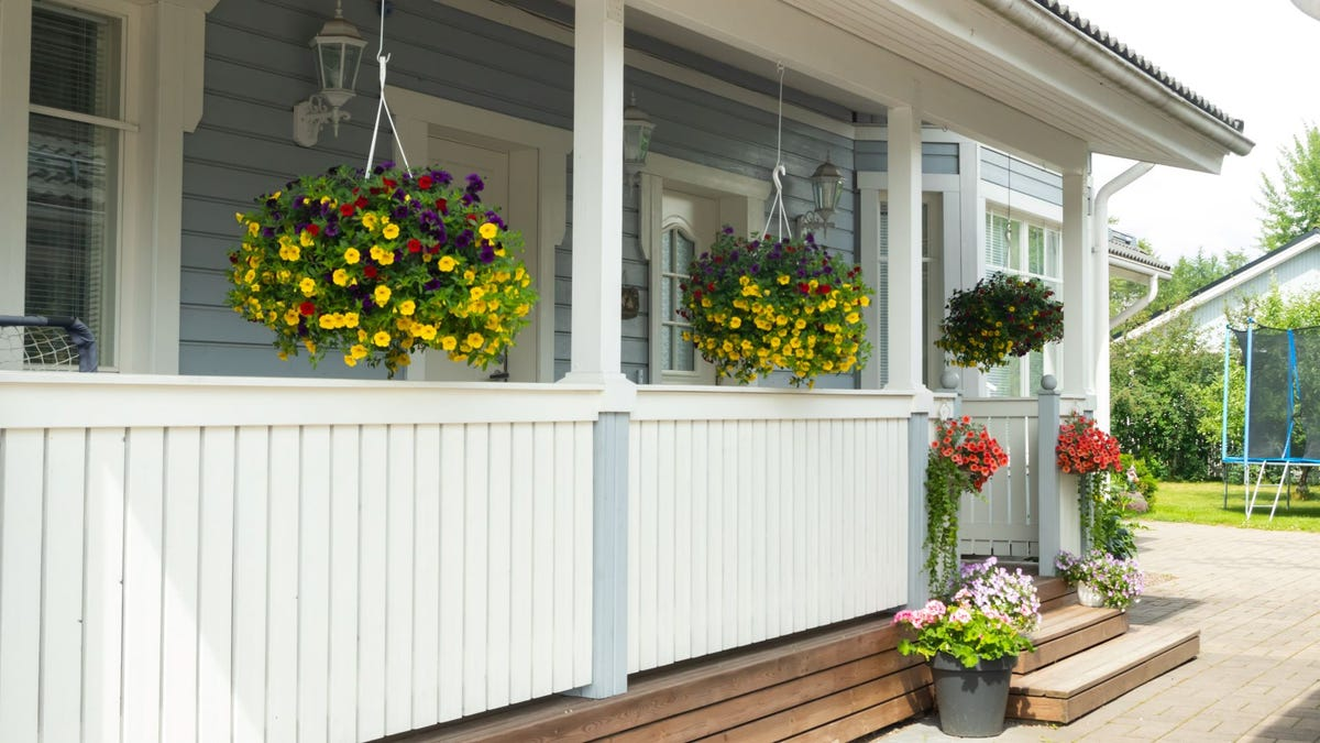 A front porch with colorful flowers.