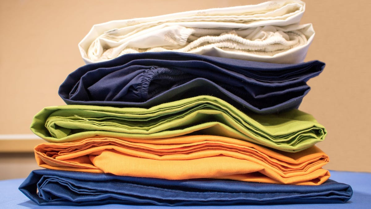 A stack of folded fitted sheets.