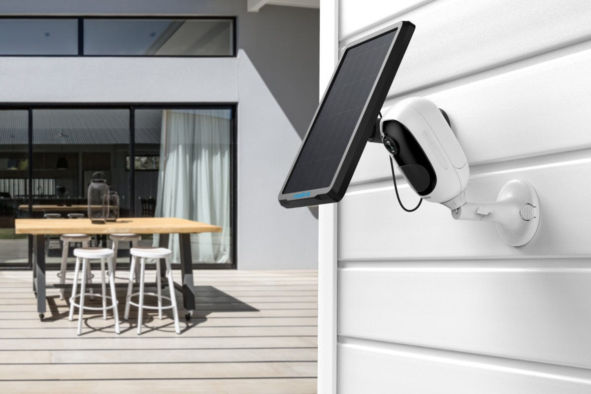 An outdoor security camera with a solar panel to charge the battery.