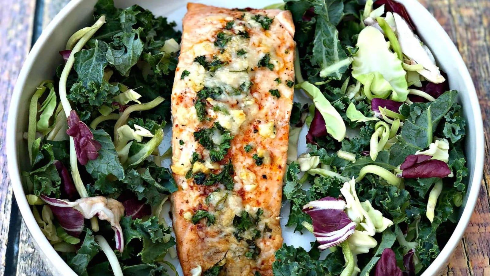 Parmesan herb crusted salmon served with fresh greens.