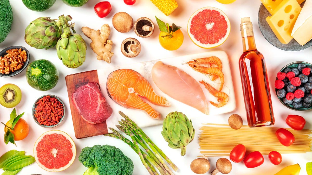 A variety of fruits, meats, and vegetables on a white background.