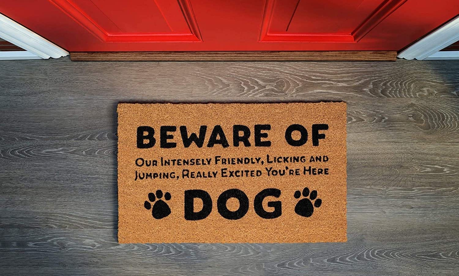 """A doormat reading """"beware of our intensely friendly, licking and jumping, really excited you're here dog"""""""